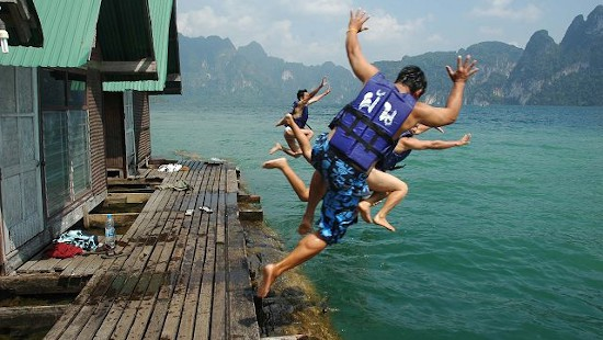 Jumping into Cheow Lan Lake